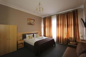 A bed or beds in a room at City Hotel Gotland