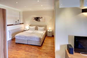 A bed or beds in a room at Appartements Coloman