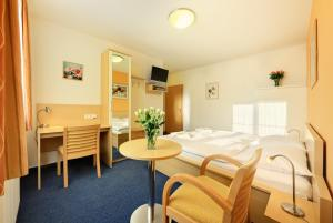 A bed or beds in a room at Penzion Krumlov - B&B Hotel