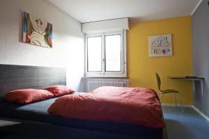 A bed or beds in a room at Budget Hostel Zürich