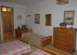 Ένα ή περισσότερα κρεβάτια σε δωμάτιο στο Elati Apartments