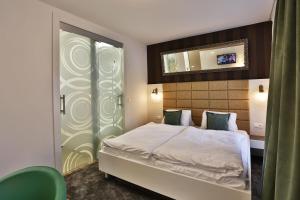 Posteľ alebo postele v izbe v ubytovaní VIP Apartments