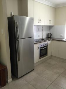 A kitchen or kitchenette at Bluewater Harbour Serviced Apartments