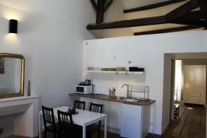 A kitchen or kitchenette at Maison Charles Maurice