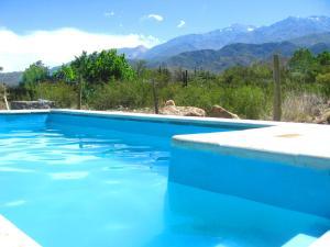 The swimming pool at or near Las Espuelas Casas de Montaña