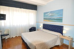 A bed or beds in a room at Hotel Sole Mare