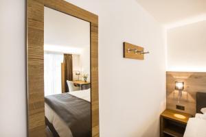 Ein Bett oder Betten in einem Zimmer der Unterkunft Romantik Hotel le Vignier
