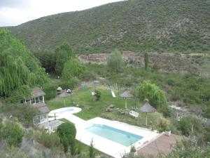 A view of the pool at Cabañas Los Arreboles or nearby