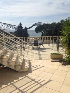 Balcon ou terrasse dans l'établissement La Résidence du Cap
