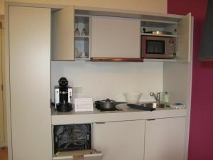 Küche/Küchenzeile in der Unterkunft Key Inn Appart Hotel Parc de Merl