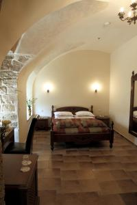 A bed or beds in a room at Akkotel-Boutique hotel