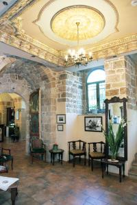 A restaurant or other place to eat at Akkotel-Boutique hotel