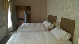 A bed or beds in a room at The Central, Buncrana