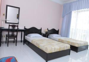 A bed or beds in a room at Thao Nhi Hotel