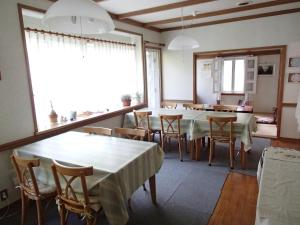 A restaurant or other place to eat at Yatsugatake Pony Youth Hostel