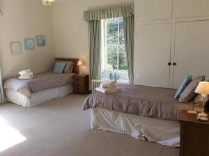 A bed or beds in a room at Rock Moor House B&B