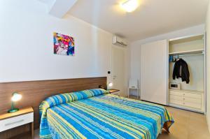 Postel nebo postele na pokoji v ubytování Villa Marina
