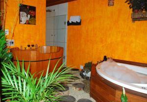 Um banheiro em Pousada Recanto Da Serra