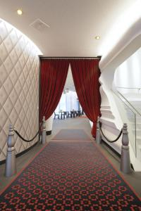 A bed or beds in a room at Kameha Grand Zurich, Autograph Collection