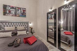 Cama ou camas em um quarto em St. George's Vatican Suites