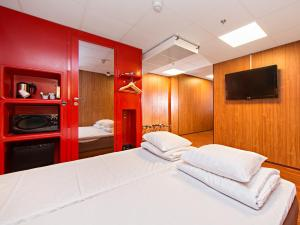 A bed or beds in a room at Omena Hotel Helsinki City Centre