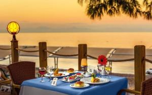 A restaurant or other place to eat at Crystal Aura Beach Resort & Spa