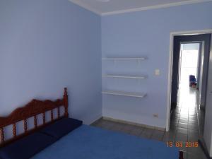 A bed or beds in a room at Apartamento no Varandas de Itaguá