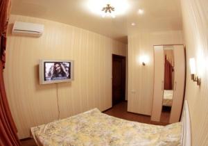 Кровать или кровати в номере Флагман