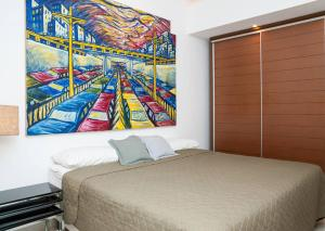 A bed or beds in a room at Leblon Dream Apartment