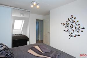 Säng eller sängar i ett rum på Serviced Apartments Malmö