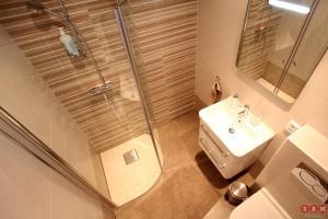 Ett badrum på Serviced Apartments Malmö