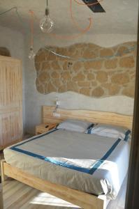Een bed of bedden in een kamer bij Agriturismo La Collina