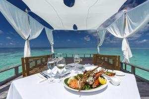 A restaurant or other place to eat at Baros Maldives