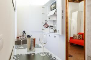 מטבח או מטבחון ב-Old Rome Apartment