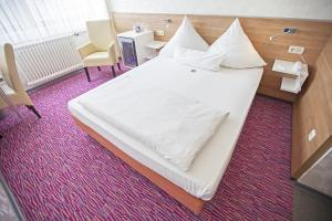 A bed or beds in a room at Am Bismarck