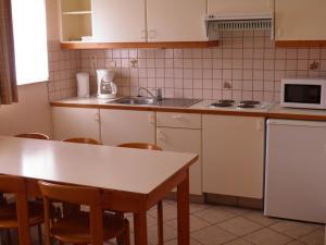 Küche/Küchenzeile in der Unterkunft Domein Westhoek Apartment
