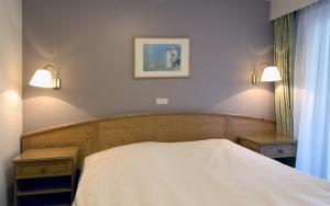 Ein Bett oder Betten in einem Zimmer der Unterkunft Domein Westhoek Apartment