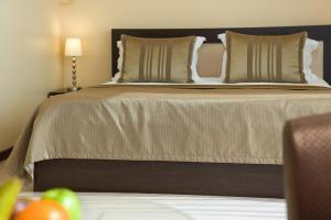 Кровать или кровати в номере АС Отель