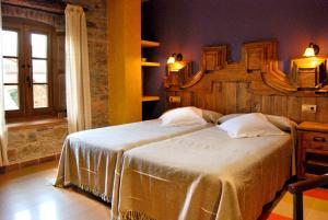 Cama o camas de una habitación en Posada Real La Lechería