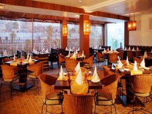 Un restaurante o sitio para comer en Hotel Palace Heights