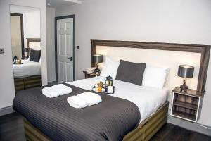 A bed or beds in a room at Base Serviced Apartments - Sir Thomas Street