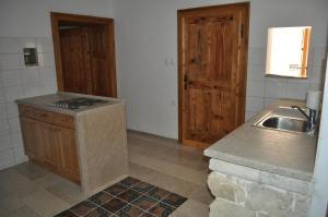 Kuhinja oz. manjša kuhinja v nastanitvi Apartments Koptur