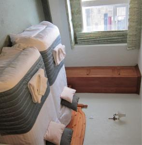 A bed or beds in a room at The Old White Lion Hotel