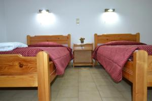 A bed or beds in a room at Koskinas Apartments