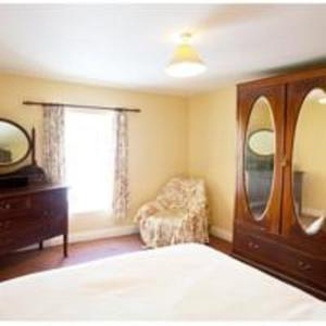 A bed or beds in a room at Jack O'Rourke's Bar & Accommodation