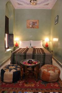 Un ou plusieurs lits dans un hébergement de l'établissement Riad Lalla Aicha Hotel & Spa