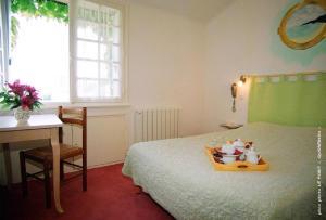 Un ou plusieurs lits dans un hébergement de l'établissement Hotel Men Er Vro