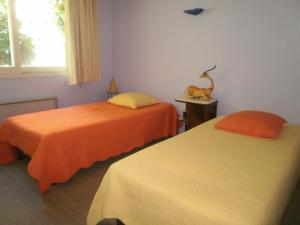 A bed or beds in a room at Face au Sancy