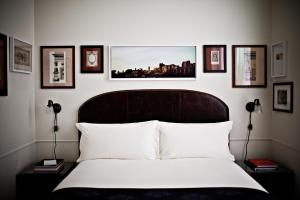 A bed or beds in a room at The NoMad Hotel