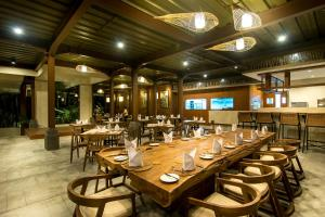 A restaurant or other place to eat at Anumana Ubud Hotel